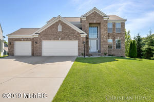 This amazing 4 bedroom, 4 bath Crystal Springs home has been tastefully updated to make it essentially brand new! Immediately as you walk in you see the grand foyer with exciting stone accent wall. New solid oak flooring flows throughout the main level. The kitchen includes new maple cabinets, new granite countertops, new tile backsplash, new stainless steel appliances and much more! The open concept is perfect to keep those in the kitchen involved with those into living room. The living room has a gorgeous colorful new stone fireplace with electric/gas insert. Step outside of the eating area through the new heavy duty slider to the deck overlooking the backyard. The half bath is all new with a fun tile accent wall. Heading down to the basement, every inch is brand new, from the wet bar to the flooring and full bath. Enjoy the basements walkout to the stone patio and backyard. Upstairs is all brand new carpet, 4 bedrooms with an extravagant master suite with vaulted ceiling and its own huge master bath with separate shower and bath tub. And don't forget the huge walk in closet. The extra large 3 stall garage has a brand new doors on them. The furnace is new as well! This location is tough to beat being very close to M-6, schools, and Gaines marketplace with tons of restaurants and entertainment. Come see this for yourself today!