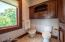 Private master en suite water closet includes bidet and plenty of additional storage.