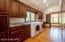Laundry / Mud Room offers an abundance of storage space. Distant powder room is convenient to kitchen and garage.