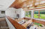 Volume ceilings are embellished with cedar planking and complemented by massive exposed beams.