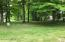 Vacant land parcel adds an additional 155' frontage and 1.3 acres to the estate.