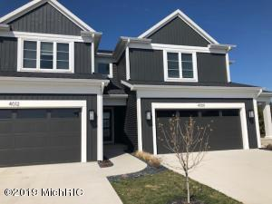 Modern look! Carbon vinyl siding, Brazil nut stained entry door with Chinchilla glass that allows for plenty of natural light while maintaining privacy, 2 car attached garage flanked with large modern light fixtures, large windows, private patio, community pool and pool house.