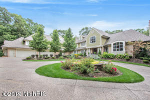One of West Michigan's finest homes, this breathtaking estate sits on over a private 9 acres with a gated entrance. Peace and tranquility, yet minutes from downtown Ada. 7 bedrooms 8 full baths and 2 half baths with nearly 12,000 sq feet of living area.  Some updates include new roof, furnace and carpet throughout. Spacious master suite with private patio large walk in closets, bathroom suite and private office. New gourmet kitchen with large center island and dining area. Beautiful custom staircase leads from main floor living room to lower level living room and second kitchen/entertaining bar. The guest quarters has a separate entrance. Outside you will find a childrens play ''park'', all sports court, salt water pool/spa outdoor grilling area with patio that will surely impress.
