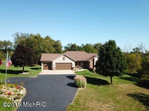 Beautiful 4 Bedroom, 3 Bath Home on 10 wooded acres in Zeeland School District.  Very convenient to Zeeland, Holland, Hudsonville, & Grandville.  Relaxing  views of wildlife, weather, sunrise & sunset.  Area is also great for all of your toys, snowmobile's, ATV's etc.  This spacious home is perfect for entertaining and comes with lots of storage, large bedrooms, closets, large utility room and cathedral ceilings.  Home iincludes solid oak doors, windows, cabinets, & a walkout lower level.  Lot has underground sprinkling & plenty of room for a large barn without disturbing your views.  Three stall garage is insulated & finished.  This warm inviting home has been very well taken care of and is ready for new memories.