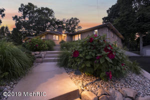 Front Elevation view at Dusk photos of nicely lit landscaping and beautiful entrance
