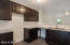 Stock photo - kitchen will have castled cabinets, granite counters and tile backsplash.