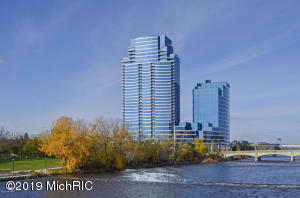 """Welcome To River House Condominiums with fabulous lifestyle amenities such as on-site gym,indoor heated pool & hot tub,Club Room for private events,lobby lounge,24-hour concierge,onsite storage facility & two covered parking spaces.This condo is situated on the 26th floor in the highly desirable SE corner of the building. It is one of the most popular & sought after units with outstanding views of downtown Grand Rapids,Grand River & Medical Mile.Along with floor-to-ceiling glass exterior walls and a great floor plan including 3 bedrooms & 3 full baths you will be delighted to see the fully remodeled unit with high end amenities such as heated tile floors in the kitchen, dining room & bathrooms,kitchen with granite counters and imported soft close cabinets,stainless steel appliances, custom Hunter Douglas blinds, Bosch washer & dryer, ceramic tile flooring and new carpet 2018. Master bedroom suite includes Italian tile with Swarovski crystals in the tile over the tub emulating a waterfall, LED lighting under the floating cabinets. 2nd bath includes """"Opera"""" glass tile, and 3rd bathroom has a Brazilian Azul Macauba tile. All bathrooms have imported high gloss Euro cabinets, quartz counters and high end fixtures throughout.Custom Murphy bed/cabinetry in 3rd bedroom. The attention to detail is unmatched.You add in a breathtaking view from your balcony which includes a front row seat to fireworks and you have one of the best condos in the city. Come tour this fabulous condo today!"""