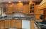 Featuring an appliance garage and granite countertops.