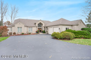 Welcome to this stunning, meticulously maintained former parade home built by Doug Summner. This executive ranch home is located in one of the most desirable neighborhoods in Caledonia. As you enter the large, welcoming foyer you will be delighted with the beautiful formal living room and large windows with stunning view. The kitchen continues to please with large center island, plenty of hard surface counter space, walk in pantry, dining area and door to outdoor deck. Continuing on the main level, main floor laundry room, 2 spacious, comfortable bedrooms and master suite with it's own fireplace, bath and walk-in closet. The lower walk out level offers a family room, rec room and stunning wet bar. The 4th bedroom and 3rd full bath is perfect for visiting guests. An additional 5th bedroom is waiting to be finished. Come see! You won't be disappointed with this traditional, timeless home. Square footage per county records.