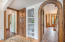 Walk-in pantry and stunning wood archways.