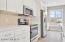 Entertaining Kitchen - Quartz Countertops, Tile Backsplash & Stainless Steel Appliances