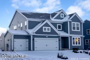 Brand new custom home in Hanna Lake Trails. 5 Bedrooms 4.5 Baths. Open concept main floor opens to large deck with stairs to gracious concrete patio. Generous master suite. Additional bedroom suite with private bath as well as jack and jill suite. Laundry room completes 2nd floor. Daylight basement features another bedroom full bath family room and approx 18x20 room that could easily be finished with daylight windows. Caledonia schools