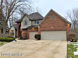 In the Grandville School District and formerly in the Parade of Homes, you will not believe how immaculate the owner has kept this home!  Walk in the front door to a 18 foot vaulted ceiling/foyer, living room and formal dining room with high ceilings throughout the house. You will love the spacious kitchen with maple cabinets and large island.  There is an eating area with a deck that leads to a great room with a fireplace and built in entertainment center.  The upper level has 4 bedrooms and a full bath as well as the master suite with a recessed tray ceiling.  Master suite is quite spacious and big enough to have a sitting area.  The master bath has a large jacuzzi tub and walk in shower. You will enjoy the secluded and wooded backyard with a nearby walking path that will take you to a pool, tennis court and clubhouse which can be used for gatherings.  Hot and cold water available in the three stall garage.  The unfinished walkout lower level is plumbed for another bathroom. You could add another bedroom and extra living space or create a huge rec room.  French door in the lower level leads to a Hot Springs 5 person hot tub.  There are double doors off of the storage area which is perfect for storing your riding lawn mower and yard equipment.