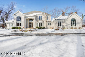 Proudly presenting 4844 Summer Ridge Ct! The scenic drive accented with century old trees leads you to this 4+ acre property with your choice of Forest Hills Northern or Eastern schools. Walkable to scenic Roselle Park and less than 15 minutes to downtown Grand Rapids make this 6 bedrooms, 4.5 bath showpiece a highly desirable place to call home. This home boasts floor to ceiling windows, incredibly spacious bedrooms all with an adjoining bathroom, laundry room on both levels, dual stair case, tray ceilings and both formal and informal living spaces! You must get inside this home to truly appreciate the floor plan and incredible craftsmanship. You wont find a better value on lot size coupled with a really competitive price per SF. Truly an INCREDIBLE value!