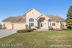 High quality design and finish on the 6th hole of Gleneagle Golf Course. 5 bed/3.5 bath home in the Jenison School District. The main floor boasts a large, bright living room with high ceilings & gas log fire place, formal dining room, second eating area, large office with built in bookshelves, 2 bedrooms with 2 closets each, a full bath, & half bath off the living room. Upstairs is a large master suite with 2 walk in closets, a master bath with jacuzzi tub, standing shower, dual vanity, & a large linen closet. The lower level is a walk out with a rec room, 2 bedrooms, a full bath, large finished laundry room, & a fantastic workshop with french doors leading to the patio. Large composite deck and paved patio, and 3 stall garage attached. A special home with class and character. See it now.