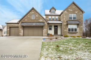 Stunning 2018 Parade Home Custom Built By Eagle Creek Builders Located In Railview Ridge Which Is Connected To The Railside Golf Course Community! As You Enter You'll Notice The Sprawling Open Floor Plan With 2-Story Great Room That Features Custom Stone Fireplace & Mantle ! Gray Shaker Kitchen With Large Center Island, Quartz Counters, Specialty Appliances & Custom Range Hood! The Main Level Offers A Huge Master Suite With Coffered Ceiling, Private Bath With Marble Shower & Dual Vanity + Walk-In Closet! Upstairs You'll Find 2 Beds With Jack & Jill Bath + Loft Space. The Current Owners Spared No Expense Finishing The Basement With Stunning Wet Bar, Large Entertaining Space, Bedroom, Bath + 2 Flex Rooms! Beautiful Lot Just Seconds From The Golf Course! Too Many Special Details To List!
