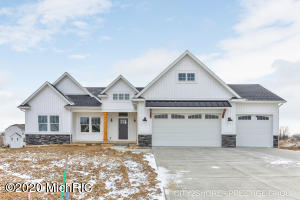 Are you ready for a move in 2020?  This home is complete and is waiting for you.  The main level of this sprawling ranch is almost 2000 sq. ft and has so many exquisite details.  Great room features beamed high ceilings, gas fireplace with custom built ins and abundant natural light.  The large kitchen has plenty of cabinets, quartz countertops, stainless steel appliances, tiled backsplash, and a walk-in pantry with space for those small appliances.  Did I mention the huge quartz island for plenty of prep space? Located conveniently off the kitchen is the half bath, mudroom with drop space for electronics, lockers, closet, laundry with soaking sink and countertop for folding.  The master bedroom features a walk-in closet with custom shelving, and shiplap wall.  The list goes on........... Master bath with dual vanity and tiled walk in shower, 2nd bedroom is a junior suite with its own private bath, and a 3rd room offers your choice of an office or bedroom.  The lower walk out level is fully finished with bar, large recreation room, 3 bedrooms, 2 full baths and plenty of storage.  All of this with a covered deck, 2x6 construction, drywalled 3 stall garage and a well-insulated home resulting in low energy bills. Call Amanda for your private showing.