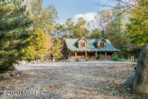 "This custom riverfront log home is nestled in the woods on the St. Joseph River less than 2 hours from Chicago, & an easy commute to Notre Dame.  Set on on 17+ acres, w/1700' of private frontage, the property has an 'Up North' feel, offering great boating & fishing, & lots of wildlife.  An easy walk to Niles, a town of 12,000, and shopping at big box stores is 30 minutes away in Mishawaka. The house itself is extraordinary, made with 100 yr old White Pine logs from Ontario, with a 'magazine quality' interior design. Douglas Fir floors & ceiling, two massive stone fireplaces, limestone counter tops, & high end appliances. In addition, the private guest quarters above the detached 3-stall garage offers great space for family or friends.  Property has an excellent income history. Floors and ceiling are Douglas fir.  Floors are varnished, and ceilings are white washed. Main level interior doors are from a 100+ year old home in Buchanan, MI. Kitchen counter tops are from a limestone quarry in Wisconsin. Massive logs average 24"" in diameter, hand hewn and full Scandinavian scribed.  Finished 1,500 square foot guest quarters are above the garage. One bedroom, one bath, and large living space, with full kitchen. Natural gas, forced air heat, and AC.   3-car garage has radiant heat throughout.  High speed internet & CATV, city water & natural gas.  Electric and natural gas lines are buried."