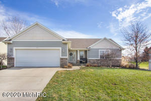 Located in the desirable Bridlewood neighborhood in Jamestown township, you'll love this wonderful 4 bedroom ranch home! Main floor boasts an open concept featuring a large kitchen with stainless steel appliances, dining area, living room with with fireplace and slider leading to deck overlooking the backyard. Main level also includes large Master bedroom with master bath and walk-in closet, another bedroom, full bath, half bath and laundry room.  The lower daylight level features a large family room, 2 large bedrooms, a full bath and storage!