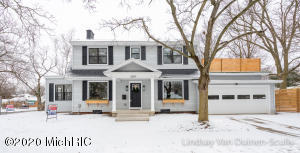 This Stunning completely remodeled 4 bed 2.5 bath EGR home is located just blocks from reeds lake, downtown gas light village & the middle/high school.  You will love the beautiful custom trim molding featuring coffered ceilings in the kitchen and dining area, arched doorways throughout the main floor and floor to ceiling wainscoting in the sun room.  The kitchen features brand new white shaker cabinetry, granite counter tops, custom built hood, bar seating and walk in pantry.  The master suite has a walk in closet, gorgeous modern bathroom with double sinks, tiled shower with glass door and rain head fixture.  Also, don't miss the one of a kind private roof top deck featuring artificial grass that can be used year around.  The finished basement has a great rec room area, 4th bedroom... and wet bar.  Home has a brand new roof, black windows, electrical & plumbing. Furnace, Ac & hot water heater are 7 years old. Basement also has a professionally installed waterproofing system.  Don't miss out on this one. Seller is a licensed Real Estate agent in the state of Michigan selling for profit or loss.
