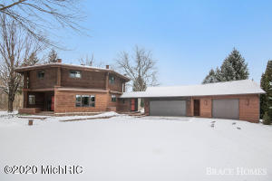 OPEN HOUSE: Saturday, Feb 22 11-1 PM! Not Your Average Cookie-Cutter House; You Will Love How Unique & Well Cared For This Home Is! A Rare Opportunity For 2 + Acres In The Heart Of Grandville Schools, Close To Shopping, Restaurants & Easy Access To The Expressways! Main Level Offers Solid Woodwork Throughout Kitchen, A Formal Dining Room That Shares A Double-Sided Fireplace With The Living Room, Dedicated Office Nook + Sun Room & Sitting Area! 4 Bedrooms Upstairs Including A Private Master Suite. Outside Enjoy Nature On Your Sprawling Deck + You'll Have Room To Store Plenty Of Toys With The Attached 3 Stall Garage That Includes A 450 Sq. Foot Workshop & Additional Detached 1 Stall Garage! Please See Attached Upgrade List As There Are Too Many To List!