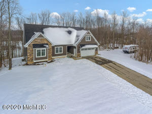 This home is a showstopper with roughly 3700 finished square feet. If you love nature, privacy, kayaking, and beautiful views this is the home for you. The main floor features a huge kitchen with granite countertops, white cabinets, stainless steel appliances, cozy family room with gas fireplace with lots of windows overlooking the water, master bedroom with private bath and walk-in closet, laundry room, and two additional bedrooms and this is just the main floor. Upstairs you will find the perfect use of space adding a bonus bedroom/office. Now on to the basement with a newly finished kitchen area, a massive family room with high ceilings, a 5th bedroom, and a full bathroom with tiled shower. This is simply a must see so schedule a private showing today.
