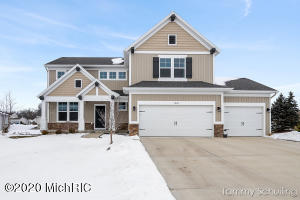 This 4 bedroom, 2.5 bath home is located in Kenowa Hills School District..    The kitchen has granite counters, stainless appliances, full tile back splash, center island and a large walk in pantry.  The living room has an electric fireplace with floor to ceiling stone mantle.  Upstairs: large loft, 3 Bedrooms, full bath, plus master suite w/walk in shower and huge walk in closet.  The daylight basement could  be easily finished which would add another large living room, another full bath, and a fifth bedroom with a walk-in closet.  The basement has been framed and the bathroom has been plumbed.  This home offers 2.466 finished sq ft., 2 story foyer, 9' ceilings, den/flex room. open floor plan, 3 stall garage, deck. large main floor laundry and half bath off mudroom, new washer/dryer, custom Hunter Douglas window treatments, underground sprinkling and professional landscaping, seamless gutters, WiFi smart thermostat, 2 WiFi garage door openers, built-in shelving in the garage and basement.  Home is located on a dead end street, low traffic.  Zinser Elementary one block away. Fred Meijer trail runs adjacent to property.  Standale Shopping a short walk away.