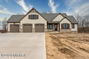 Schultz Builders is proud to present this New walkout ranch home located in Fox Meadows Estate of Hudsonville.   Loaded with extra's throughout the interior and exterior with attention to every detail.  Open floor plan encompasses kitchen with walk in pantry, large center island, walk in spacious living area with fireplace center within built in's on each side,  cover screened in porch just of the eating area overlooking the waterfall pond  to the north and wooded  back yard.  Master suite and den/office are privately located on the main floor. Walkout basement with 9 ft ceilings, amazing layout for entertaining with bar area, wine cellar. family room and gaming area. Three additional bedrooms/office or workout rooms complete this fully finish space.