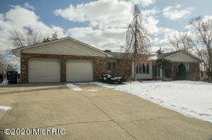 Nearly 4000 sq ft of finished living space on the desirable all sport Rushmore Lake.  Very hard find in Jenison schools.  Lot's of potential here.  4 plus bedroom, large kitchen with huge walk in pantry and center Island.  Large living room with fireplace and sliders to deck.  Walk out basement with wet bar, fireplace and a lot of living space.  Multi level deck and beautiful views of RUSHMORE lake.   See it today!!!