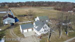Truly a once in a lifetime opportunity!  23 acres in the heart of Jenison, meticulously cared for & loved by the owners.  Fantastic location offering 4 parcels reaching all the way from 12th Avenue to Woodcrest Park on Baldwin St.  Well appointed 3 bedroom farm house with attached garage & huge 3 season porch.   Entry to a wide open front living room, updated custom kitchen (appliances to remain), snack bar, dining area with built in storage space & tucked away computer desk.   Main floor laundry & full bath.  Upper level offers 3 bedrooms (plenty of extra closet space) & full bath.  Lower level has nice clean space that could be finished & offers tons of room for storage.  Also includes a great 36 x 48 pole barn, & 2 add'l buildings.  Rare, awesome hobby farm with development potential! Seller directs offers to due for review by Friday, March 13, 2020.