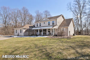 Perfectly situated on 4.9 acres, this spectacular home overlooks its own nature preserve, abundant with wildlife and plenty of great views. Sitting among just 10 homes on this private cul-de-sac street, buyers are sure to appreciate being conveniently located to schools, shopping, golf and the Cannonsburg Ski and recreation areas. This 2-story home offers 5 bedrooms plus an office, 4 full and 1 half baths, over 4,500 sq. ft. of finished living area and a 3-stall garage. The well-appointed kitchen has a center island with snack bar, pantry, and an adjacent dining area with access to the oversize deck. Beautiful Corian counter tops and tiled backsplash in the kitchen as well as oak hardwood and ceramic tile flooring throughout the high-traffic areas. Boasting southern exposure, and a two-level wall of windows, the living room also has a wood burning fireplace and stunning floor to ceiling split stone hearth and facade. The impressive master suite has a gas fireplace, private deck access, trayed ceiling, walk-in closet and private bath with sharp updates, jetted tub, separate shower, and twin sink vanity. There is also a main floor office, a more formal living room (possible formal dining room), laundry room and ½ bath. The upper level has 3 bedrooms plus a great bonus room with transom window that would be a great office or study area. One of the bedrooms has a private bath and the other 2 bedrooms share a Jack-and-Jill bath. The walkout lower level is sure to please with a large family and rec rooms, 5th bedroom, full bath, large exercise or flex area, and plenty of storage. Highly efficient closed-loop geo thermal heat, central air, Kinetico water softener, and so much more.