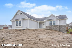 Beautiful new construction in Grandville schools! Quality and character abound in this new home on a spacious corner lot. Open floor plan with vaulted ceilings and plenty of natural light, large kitchen with island big enough to seat at least 4, quartz countertops, soft close cabinets, slate finish appliances, large dining area. Main floor master with ensuite bath and walkin closet, a second bedroom and full bath. Mudroom with large laundry room and a roomy closet for storage. Lower level finishes off the home with a family room, 2 more bedrooms and full bath. This home is a must see, schedule your private showing today!