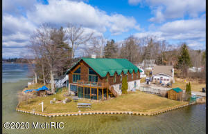 A beautifully hand crafted, Luxury Log Home featuring 7 bedrooms+nursery, 3.5 baths, 3 car garage, paved parking for 5 vehicles, screened in patio, hot tub room, large fire pit and sandy bottom frontage.175 ft of lake frontage on all sports Derby Lake.  Residents enjoy a modified ''no wake'' policy before 11am and after 7pm; allowing for perfect fishing in the mornings, plenty of water sports during the day and relaxing pontoon rides in the evening. Ice fisherman rave about Derby's deep waters and natural spring.Just minutes from championship golf, shopping, The Sidney Tavern, General Store, Sidney State Bank and historical downtown Stanton, this home is the perfect getaway.  Sleeping up to 25, this stunning home offers a wonderful opportunity for those who are Air B&B savvy.