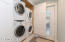 2 stacked washers & dryers.