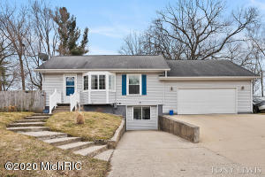 Offer has been presented highest and best offers due 3/17/20 by 8pm. Nice 3BR home nicely updated w/new paint, vinyl flooring, and carpet. Large fully fenced back yard with large 2 tier deck. Large 3 stall garage 24x32, fully finished lower level, shed, all appliances stay including washer & dryer, mostly newer vinyl windows, 2 yr water heater, 11 yr furnace, (hardwood floors under carpet), super low utilities aprox $50 gas $50 electric. Walker Michigan and close to downtown. Room desc: lr,kit,ea, 2br, ba Dn:fr,br,office area, laundry and mechanicals