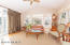 Sunroom with vauled ceiling /adjacent to the kitchen/casual dining area