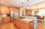 gas cooktop, newer stainless appliances and spacious walk-in pantry