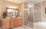 oversized shower with dual-head shower fixture