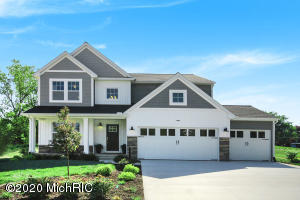 Model home for sale available Spring 2020, 4 bedroom, 2.5 bath, 3 car garage home in Hanna Lake Trails, conveniently located near the M-6 South Belt-line in the Caledonia school district. Amenities within the community include a 3-hole disc golf course and walking paths. RESNET ENERGY SMART HOME.  Welcome  home, to over 2,700 sq. ft. of living space that seamlessly blends space with style. The large two story foyer greets you and leads in to a den with french doors. Continue into the expansive great room and large dining area which is open to the gorgeous kitchen, featuring, castled cabinets, center island, granite counters, tile backsplash and SS appliances.  A mud room with built in bench, plus a walk in utility closet are convenient for storage. Upstairs features a master suite with a large WIC and private full bath featuring a dual bowl vanity. 3 more spacious bedrooms, another full bath and 2nd floor laundry room complete this home. Beautiful core-tec flooring on main floor.