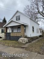 Great opportunity for an investor or homeowner to gain some sweat equity with this one. New roof and windows, inside is currently gutted to studs. Off-street parking  in the rear. Lots of potential. Schedule your showing today!