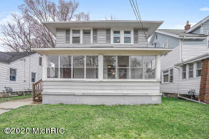 MULTIPLE OFFERS RECEIVED.  Highest & Best Due 3/23 at 6pm. AGENT REMARKS. Gorgeous 1920's home that has been meticulously freshened and ready for its new owner!  Steps from the bustle of Eastern and Burton you can walk to you local grocery store, grab a bite for dinner at the Old Goat or Real Food Cafe's delicious breakfast!  Walk into you new front 3 season porch and fall in love!  The main floor shows off stunning hardwood floors, almost 9 ft ceilings and custom trim-work throughout!  Set up with entertaining in mind, the main floor flows from the living space to dining and kitchen.  The cabinet filled kitchen offers new countertops, tons of natural light and new flooring!  The main floor also shows off a Light Filled private Master Bedroom or office/den space overlooking your backyard. Heading upstairs to the bedroom level, discover three generous bedrooms with gorgeous hardwood flooring and a stunning full bath with tub.  The lower level is great for storage or finishing another living space for a rec room!  The one-stall detached garage is off centered in the back yard which has two sides of privacy fencing.  Tour today before it sells tomorrow!