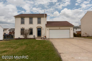 Terrific 2 story home in Kentwood is now available!! This home features 4 bedrooms and 2.5 baths with an amazing 3+ stall garage (additional stall and work space added to the back) and additional driveway parking. Main level consists of the living room, diningroom with sliders to large deck, kitchen and laundry/half bath.  The lower level boasts a family room or game room or man/woman cave or whatever you see fit, and an additional bedroom.  Lower level bedroom could use some finishing touches (ceiling or paint trim and additional lighting hook up. Inside the lower level bedroom is the possibilty of an additional bathroom.  Seller is leaving many supplies to complete it (Shower, toilet, lighting etc). In the upper level you will find a full bathroom, 3 bedrooms, including the master bedroom with walk in closet and additional full bathroom.  Let's talk a little bit more about this amazing garage..Heavily insulated, plenty of outlets, 220 ran to sub panel(just needs to be tied in), plumbed for a gas furnace, plenty of space for cars and so much more, as well as storage above. This quiet neighborhood will draw you to spend time outside on the large deck entertaining or gardening in the yard. This home has it all and the Seller's are offering a 1 year Home Warranty with acceptable offer.  Be sure to watch walk through video attached. In person showings begin 4-14-2020