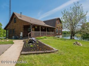 Want a lake home that has it all: seclusion, acreage, pole barn with over 600 feet of frontage and 38.5 acres (Which has 6 splits available) The original log home has been added to and now boasts over 5,000 ft of finished living space, including 2 main floor master suites, a loft area with sleeping space, 4 bedrooms upstairs - including a room with 4 built-in bunks - and 2 full baths. In the walkout level, there is a large training/living room with 1.5 baths and a sauna. The open chef's kitchen has an abundance of cabinet space. Off the kitchen, you'll find a screened-in porch with a hot tub attached to an open-air porch. The detached garage has a bomb shelter and space above that can be finished as an apartment or other living space. Also includes a full house generator and boiler