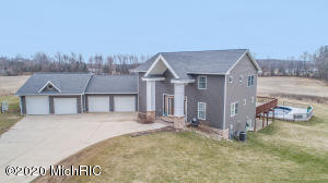 Custom built, 4,000 sqft home situated in sought-after Caledonia Community Schools! House is sitting on 2 acres  surrounded by agricultural fields. Walk in through the double front door and see the custom built, see-through, stairs with iron rod railings. There is a great room with 22 ft cathedral, ceilings, two way fireplace to be enjoyed indoor or outdoor, and 4 sliders that lead out to a 3,000 sqft deck. The gourmet kitchen features granite countertops, black stainless steel appliances, a breakfast nook, a center island, and overlooks the great room and formal dining room. Master bedroom has three walk-in closets, one being a huge walk-through closet with cathedral ceilings, and equipped with a large ensuite bathroom with separate double shower heads, Jacuzzi bathtub, and his/her vanities. Upstairs has two more bedrooms, 1 full bath, and overlooks the great room. Basement has an additional bedroom, game room, movie room, full bath, and mini-kitchen. There are two sliders that open to a concrete patio under deck, that leads to the pool. Other home features include; brick columns, foam insulation, 2 system zoned heating and cooling, and 4 stall garage (2 stalls are heated). Observe the abundance of deer and turkey from the deck. The home is near the Village of Caledonia, multiple walking trails, and is close to schools. Seller is a licensed Realtor in the state of Michigan.