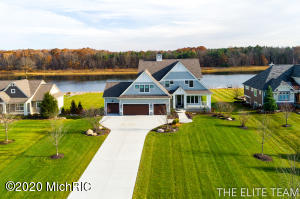 This amazing home is one of 11 homes on a private 24 acre all sports lake in Hudsonville Schools. With 5 beds and 4.5 baths and just under 6,000 total sq ft. this has plenty of space to spread out. The main floor offers large kitchen with huge island, custom cabinetry throughout, butler pantry w/sink, great room w/stone fireplace, bonus room that was originally designed as a music room, family room, office, large mud room, 1/2 bath, locker room & closet. Upstairs you'll be greeted with the owner's suite overlooking the lake, a free standing jetted tub, his and her vanities, a make up area, custom walk in shower, and finished off with his and hers walk in closets. Bedrooms 2 and 3 are generous sized and each have their own private bath. Bedroom 4 is upstairs as well and could be used as. A rec-room or play room as well. The large laundry room is also conveniently located on the second level. Head down to the walk out basement to and you will find an additional living area, a game area, large kitchenette, Exercise room, and 5th bedroom. There is also an area for a second washer and dryer convenient for lake living. There is also an extra space with doors to the backyard you can store your outdoor toys and furniture. The 4 stall garage has epoxy flooring and the 4th stall has extra high ceilings because the original design had accommodations for a golf simulator. Due to the Governors lock down order there will be no in person showings. The seller will be available for video tour. Seller will consider trades if they are in Hudsonville schools and meet their needs. Call today to set up a day and time!