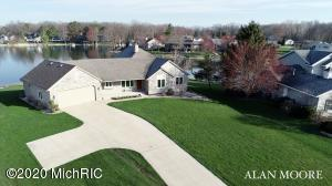 Spectacular lakefront opportunity with 175' of prime sandy beach frontage, beautiful summer sunsets and panoramic lake views. This updated ranch style home sits on a large, peninsula-like lot (.73 acre) on all-sports Lake Bella Vista and is located within the award-winning Rockford School District. Unassuming from the front, this home offers 4,000 square feet of high quality finished living area and is appropriately built to the lake, with entertaining and large family gatherings in mind. This one-owner home has 4 bedrooms, 3 full and 1 half baths, 2-stall garage (fits 3 cars) and lower level workshop and storage area lakeside. Nearly 2,400 square feet on the main level and an updated kitchen with beautiful quartz counter tops, tiled backsplash, rich cabinetry and stainless appliances. Hickory flooring through high-traffic areas. The adjacent dining area has slider doors for easy access to the deck and lake. The living room has vaulted ceilings, custom built-ins and a gas log fireplace with floor-to-ceiling cultured stone hearth. The 16' x 18' 4-season room and wall of windows virtually brings the lake to your feet. The master suite has a private bath with 2-person air tub and separate shower, walk-in-closet and twin sink vanity. Also on the main level, 2 additional bedrooms, full bath, laundry and walk-in pantry. There are also two additional bedrooms, 1 full and 1 half baths, laundry and a walk-in pantry. Much to offer on the walkout lower level with over 1500 square feet finished which includes an office, additional bedroom and full bath, full kitchen, family and recreation rooms and over 800 square feet of unfinished space for storage, workshop or additional living space or bedroom. The lakeside storage area has large double doors for easy access. Upgrades and extras include in-floor ducting, air exchanger, 4 zone heating and your choice of natural gas furnace or electric heat pump (air-to-air).