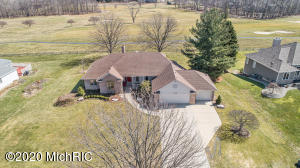 This custom quality, substantially updated home sits on an amazing site right on the 1st fairway of Railside Golf Club! Enjoy the enormous deck with long views over the course, practice range, and clubhouse. Main floor features: open floor plan; huge casement windows that allow for tons of natural light; newer kitchen with granite, built-ins, and commercial stainless appliances (Subzero, Dacor); vaulted ceilings; updated baths; solid 6-panel doors with custom millwork; 2 masonry fireplaces; paneled office; and huge master suite with spa-like bath, walk-in closet, and private deck. Amazing lower level is perfect for entertaining featuring a family room with fireplace and built-ins, and adjacent rec room with wet bar (currently used as a painting studio). Also in the lower level is an out-of-this-world, HUGE, high-end closet with custom built-ins - perfect for offseason clothing or any collection of fine things. Other notable features:  low maintenance exterior; three-car garage including easy in and out access for your golf cart; no association or fees; and easy access to the clubhouse.