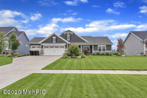 Welcome to Cory Lake! This beautiful custom built waterfront ranch in Hudsonville School District is completely turn key and move in ready! This home is an entertainers dream - fully set up with open concept kitchen/living/dining, flows nicely out to covered deck to watch the breathtaking sunsets over Cory Lake.  Basement complete with wet bar, full size refrigerator, dishwasher, microwave and wine fridge.  Recently added water softener and whole house filtration system as well as reverse osmosis throughout! 3 bedrooms on the main floor with 2.5 baths and a bedroom and full bath in the basement.  Come make this your piece of paradise just in time for summer!