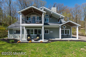 337 S Gull Lake Drive...get it ALL! Three bedroom, 3 full baths, custom finishes, amazing kitchen, 1/3 of an acre of woods with trails AND A DEEDED BOAT DOCK WITH PRIVATE PATIO ON GULL LAKE!!!