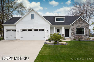 Exquisite Executive home in Unity Timbers. Quality throughout the home with a custom kitchen designed for the special chef in you with walk in pantry, Center island,  Quartz counters, built ins, and room for everyone.  The master suite is on the main level with an expansive Master bath & walk in closet. You will love the modern custom shower. There is a great view of the pond from your Sunroom and composite deck.  Main Level includes a Large Great room with fireplace, office/bedroom, mudroom, main Laundry, bonus bedroom/game room upstairs plus 2 more bedrooms, family room below.  3 stall garage as well.  Check out the 3d iGuide tour to get a personal walk through the home.
